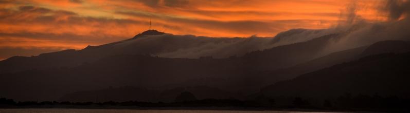 Sunset over Mt. Cargill from Pilot Beach on the Otago Peninsula