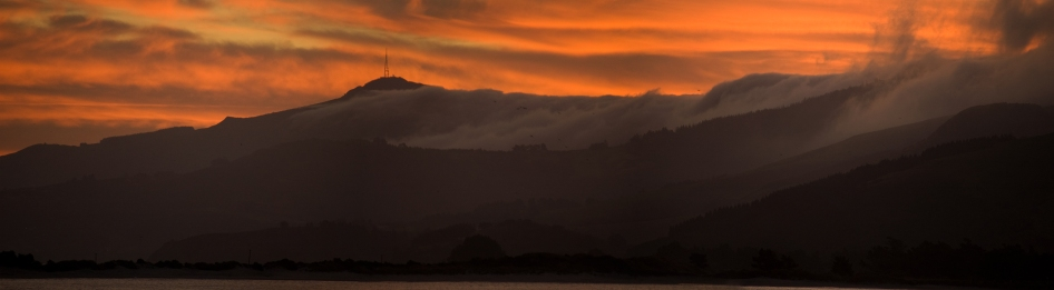 Sunset over Mt. Cargill from Pilot Beach on the Otago Peninsula