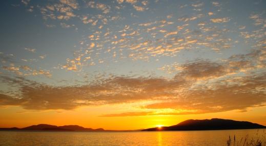 Sunset over Orcas Island (left) and Lummi Island (right)