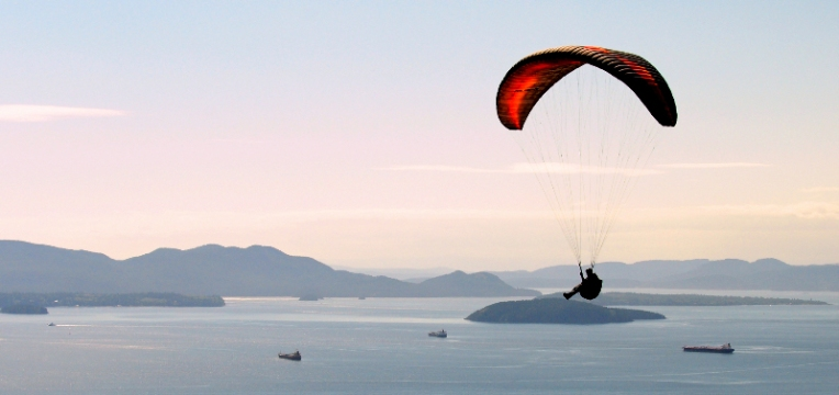 A paraglider enjoys a view of the San Juan Islands
