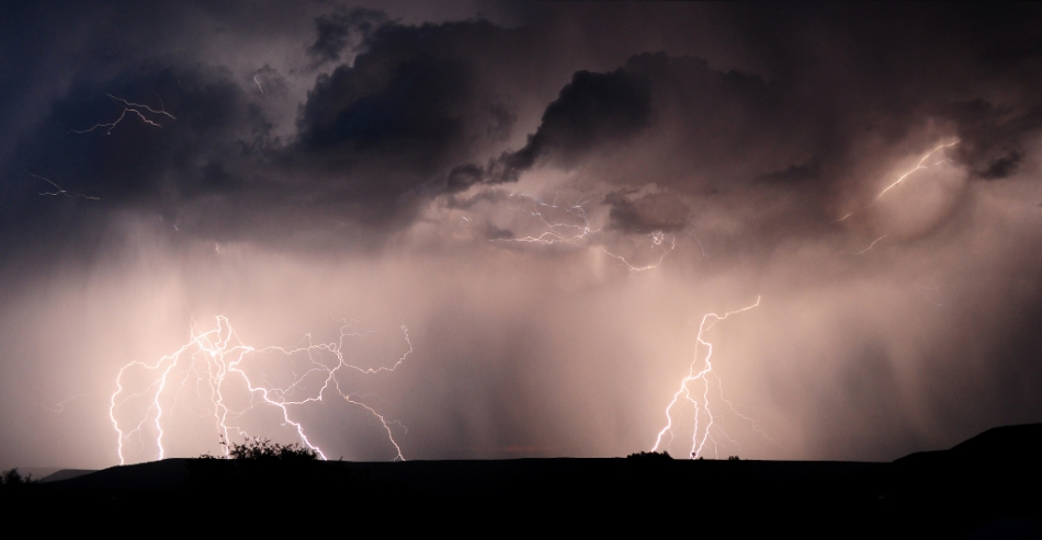 A 1-minute exposure captures several complex lightning bolts during a storm over Western Colorado on July 7th.