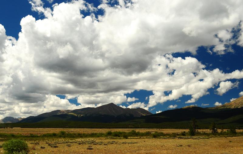 Cumulus clouds over Mt. Elbert signal a developing thunderstorm.