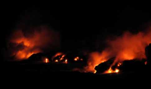 Lava flows from Kilauea Volcano entering the Pacific Ocean