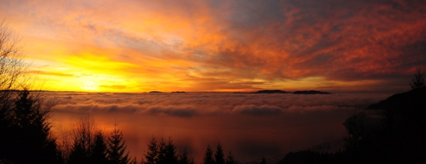 Sunset from Samish Overlook, with fog and San Juan Islands in the background.