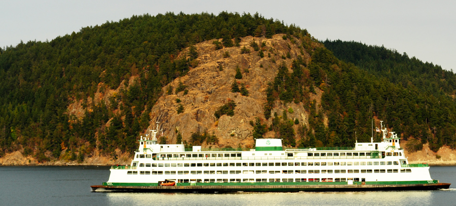 A Washington State Ferry cruises through the islands