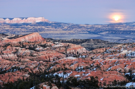 The full moon rising over Powell Point and the Sinking Ship, Bryce Canyon National Park, Utah
