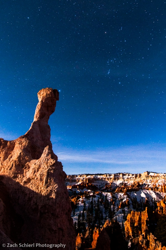 The constellation Orion hovers over the hoodoos of Bryce Canyon National Park, Utah