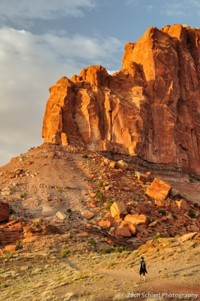 Hiking among crumbling cliffs of Wingate Sandstone, Capitol Reef National Park, Utah