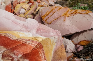 Red, pink, and yellow swirls in sandstone.