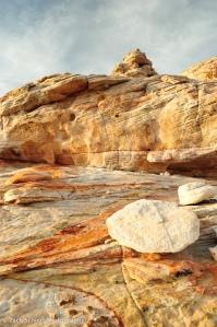 Swirls of color on slickrock sandstone.