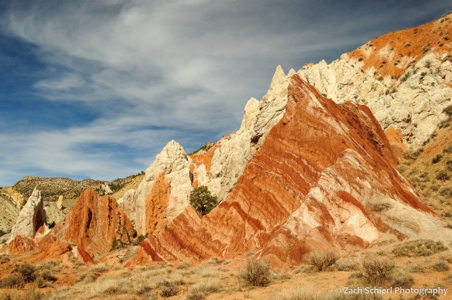 Alternating bands of white and red rock.