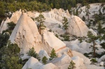 Pyramid-shaped white cliffs of tuff in golden sunset light