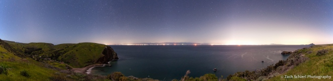 A panorama of the California coastline showing many large light domes degrading the view of the night sky.