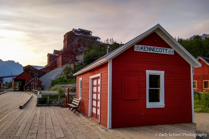 "A red and white building with a sign saying ""Kennecott"""
