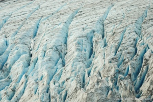Deep fissures in glacial ice