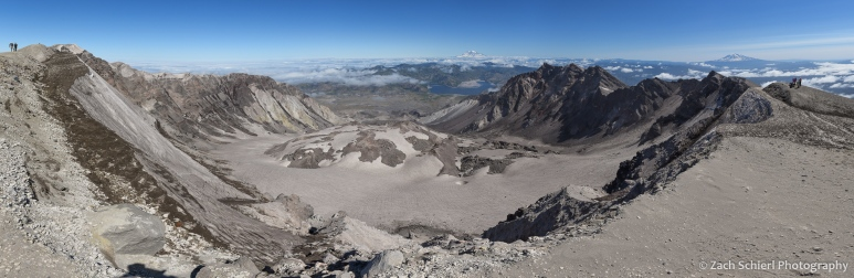 Panorama of a large volcanic crater with a mound of solidified lava in the center