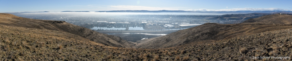 A thin layer of fog and pollution sits in broad valley.