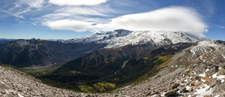 Lenticular clouds cover the summit of Mt. Rainier